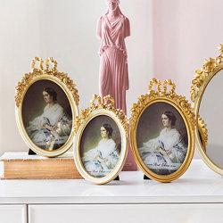 ヨーロッパ様式の樹脂のフォトフレーム金のセットアップ結婚式の彫刻された弓の写真 フレーム