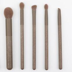 Il trucco dell'insieme di spazzola 5PCS/7PCS/PCS/12PCS spazzola lo stile sveglio di trucco di spazzola dell'insieme del contrassegno privato della polvere del fondamento di occhio dell'ombra del sopracciglio degli strumenti professionali delle estetiche