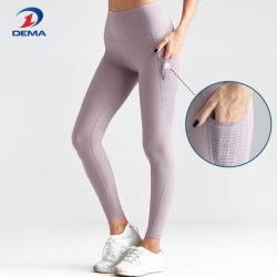 La maglia delle ghette di yoga delle donne intasca le calzamaglia correnti di ginnastica