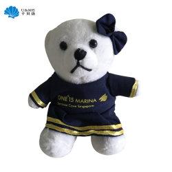 Breve oso de peluche juguete con paño vestido