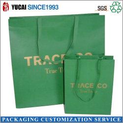 حقيبة تسوق ورق أخضر مع ورق الذهب