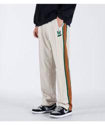 Del lado de hendidura personalizado vía emparejador de rayas pantalones hombres mariposas bordadas High Street Moda Hombre pantalones de pierna amplia