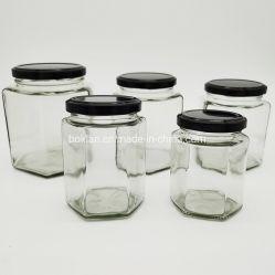 Commerce de gros pot de verre de grande capacité hexagonal pour l'alimentation de stockage de miel avec couvercle de métal