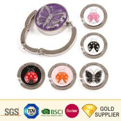 Nouveaux accessoires de mode de gros logo personnalisé de métal blanc cristal d'or de la Table du crochet de sac à main de vêtir Purse Hanger Support de sac pliable pour cadeau de promotion de crochet de suspension