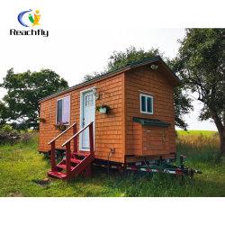 Сегменте панельного домостроения в крошечных дом на колесах// жилого дома прицепа с шасси