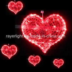 屋外の赤い中心の照明モチーフの装飾をハングさせる結婚式の休日LED