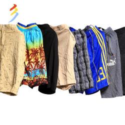 工場夏に普及した標準的な卸し売り使用された衣類の秒針の衣類の人のTシャツのズボンおよびワイシャツ