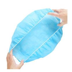 Il tipo capo non tessuto a gettare del cappello del cappuccio parapolvere ed i popolare antibatterici della clip del cappello dell'infermiera hanno arricciato l'elastico personale antipolvere senza polvere di plastica all'ingrosso lanuginoso di sicurezza