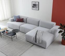 モダンなリビングルーム、 L 字型のコーナーソファ、ファブリック、モダンな雰囲気 ソファホーム家具