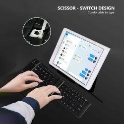 Windowsのためのタッチパッド、人間の特徴をもつIosのタブレットのiPadの電話が付いているライト便利な小型折りたたみ無線キーボードBluetoothのFoldableキーボード