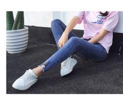 La nouvelle station de l'été Femmes Coupe irrégulière de neuf points de broderie anglaise trou Jeans