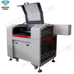 China Pas Cher Mini graveur laser CO2 avec ventilateur d'échappement et tuyau d'échappement Qd-6040