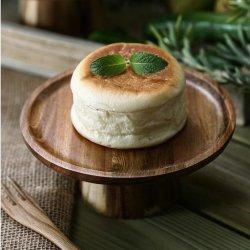 アカシアの木製の日本様式の丸いケーキの皿のレトロのケーキの立場