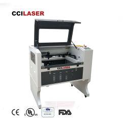 ماكينة تقطيع القطيع بواسطة الليزر ذات آلة تمهيد تعمل بالقطع بواسطة وحدة التحكم من ثاني أكسيد الكربون (CNC) الخشبية غير المعدنية LE-640-60W