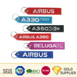 Haute qualité tissu tissé promotionnels personnalisés personnalisé Trousseau Balise clé Patch sangle de clé de la télécommande porte-clés de l'avion Patch brodé porte-clés