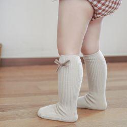새로운 재미난 무릎 양말 코튼 보우 귀여운 소녀 아기 롱 양말 키즈 유아는 양말을 기절했습니다