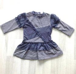 パッチワークの長い袖のスカートの赤ん坊は子供の衣服に着せる