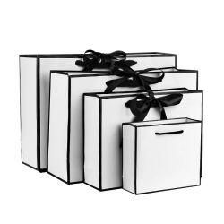 سعر تنافسي أنيق شعار العلامة التجارية الفاخرة متجر فاخر التسوق الأبيض حقائب هدايا مع عقدة