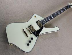 Unusalのクリーム色の整形エレキギター、金のハードウェア