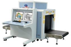Осмотр грузов сверхнормативного багажа рентгеновского сканера багажного отделения