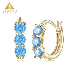方法耳のたがの青いアクアマリンが付いているカスタムHuggieのたがのイヤリング18Kのイエロー・ゴールドの宝石類