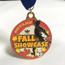 Medalla de Oro tema escaparate otoño con cordón azul