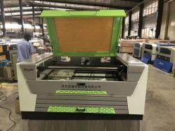 Heißer Verkauf Mini-CO2 Laser-Ausschnitt-Maschine für die Fertigkeiten, die /Leather-Kleid-aufbereitendes Modell-Industrie bekanntmachen