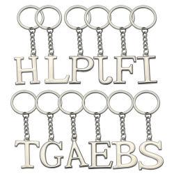 a-Zはキーホルダーの銀カラー金属のKeychainの女性車のキーホルダーの簡単な音名のキーのホールダーに文字を入れる