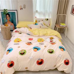 Un conjunto de algodón Four-Piece Ins solo sábanas en un conjunto de ropa de cama cama para niños