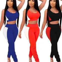 Mejor venta de las Mujeres de Color sólido Sleevelesswomens cultivo Conjunto 2 piezas Tank Top camisa y pantalones de apilado