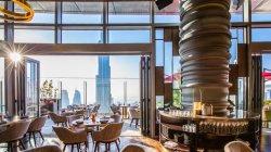 レストランのためのブラシをかけられた真鍮の端および足のベニヤの上が付いている円形のダイニングテーブル
