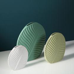 Il verde creativo da tavolino del vaso del salone della decorazione di fiore del vaso di ceramica nordico di disposizione lascia gli ornamenti floreali