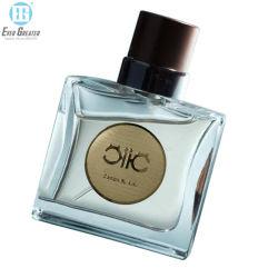 Het kosmetische Privé Etiket van het Parfum van het Metaal van de Sticker van het Embleem van het Etiket Metaal In reliëf gemaakte met Kleefstof