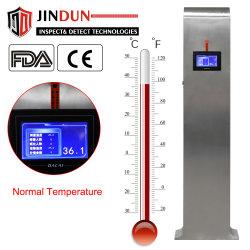 Il corpo umano di Digitahi della fabbrica si leva in piedi in su il termometro infrarosso dell'interno automatico