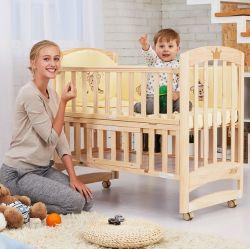 非ペンキのまぐさ桶の多機能の純木はローラーの赤ん坊のスリープの状態である折畳み式ベッドが付いているスプライスのBbの受け台である場合もある