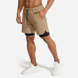 Homens Sportswear Ginásio personalizado de dupla camada de desgaste executando o treinamento Quick Dry homens curtos