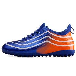 男の子および女の子のフットボールの靴、子供のサッカーの男女兼用の方法サッカーの靴、新式はゴム製Outsoleに蹄鉄を打つ