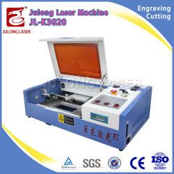 De nouvelles innovations en matière de brevets Mini Produit laser de bureau de la machine de découpe laser de la faucheuse pour trame de l'acrylique