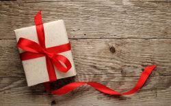 Cadeau de vacances de Noël en bois de texture du Ruban d'amour
