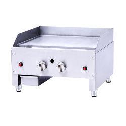 A grade do BBQ cobre o carrinho do fogão de gás que cozinha o fogão de aço inoxidável