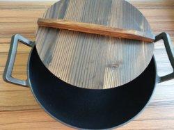 鋳鉄の木のふたが付いている日本の鉄の中華なべ
