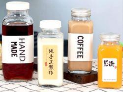 Quadratisches oder rundes Milch-/Getränkeflaschenglas mit unterschiedliche Schutzkappen-kundenspezifischem Firmenzeichen für Getränk