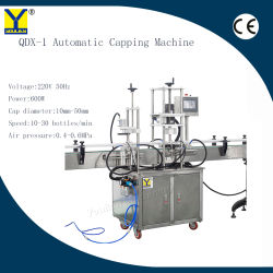 Qdx-1 botella automático de cierre de rosca Máquina Tapadora revestimiento de plástico para agua Cristal Perfume Máquina Tapadora de champú
