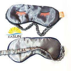 刺繍されたスリープマスクによって模造されるスリープ目マスクのスリープの状態であるマスクの綿