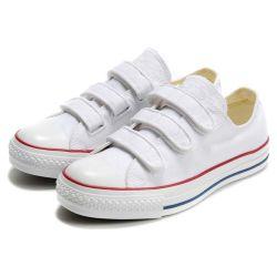 Pattini bianchi del pattino dei capretti delle scarpe da tennis della tela di canapa della pianura piana della cinghia del Velcro
