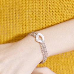 Gli accessori delle donne di modo assottigliano il braccialetto di ceramica bianco di fascino delle donne Chain d'argento