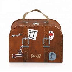 Los cuadros de la maleta de cartón decorativos artesanales