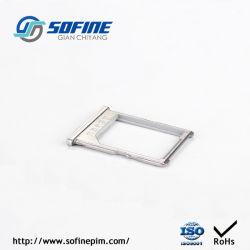 Partie en métal fritté pour logement de carte SIM avec traitement de surface PVD