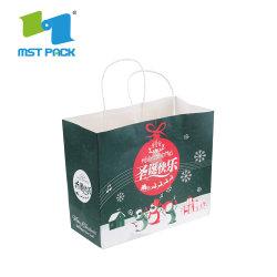 カスタム紙袋が付いているサイズによって薄板にされる物質的なクリスマスのクラフト