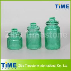 Un insieme di 3 Spray Color Glass Jar con Glass Lid